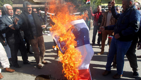 French flags burned in Charlie Hebdo protests