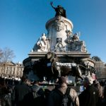 People start gathering at the statue of Marianne at the Place de la Republique on Sunday morning prior to a huge march which will end at the Place de la Nation. Photo: Joel Saget/AFP