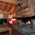 Check out the large wood and stone fireplace in the living room to brighten up those winter nights.Photo: Leggett