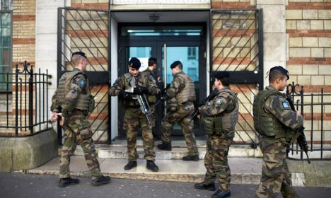 France to keep 10,000 'tired' troops on streets