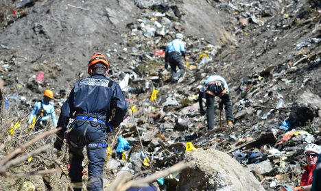 Harrowing search at Alps plane crash site goes on