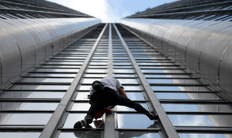 French spiderman scales Paris tower for Nepal