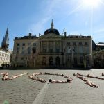 """More than thirty artists and technicians hit the ground in front of Chalons-en-Champagne city hall, eastern France in June, forming the word """"No"""" to protest against the status reform of the """"intermittents du spectacle"""" by the French government, during the """"Furies"""" circus and street festival. They, too, were naked.Photo: AFP"""