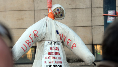 Hollande wants UberPop gone as cabbies fight on