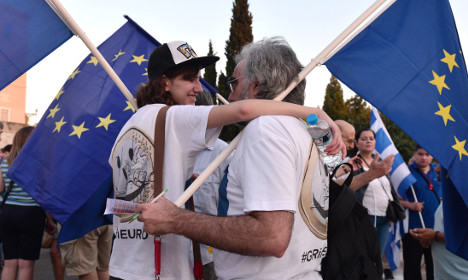 France salutes Greece but Germans sceptical