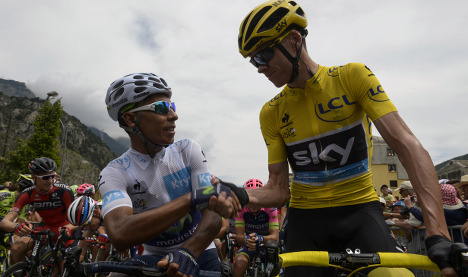 Froome defies abuse to win Tour de France
