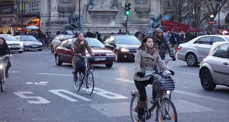 Cyclists in Paris get the green light to jump red