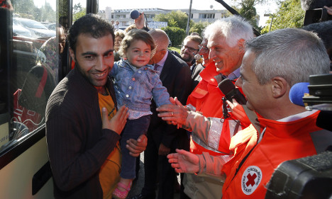 IN PICS: Refugees arrive for new life in France