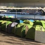 Police clear out two refugee camps in Paris