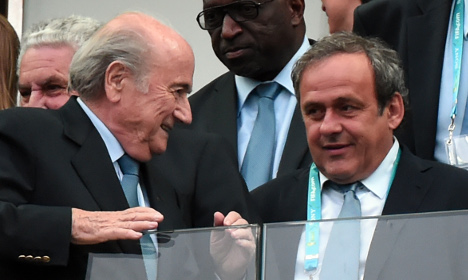 Frenchman Platini hit with suspension by Fifa