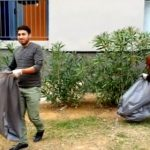 Syrian refugees clean up dirty French streets