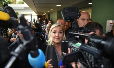 Rival parties protest TV show with Marine Le Pen
