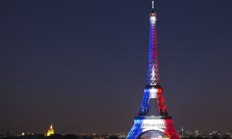 Eiffel Tower reopens with message of defiance