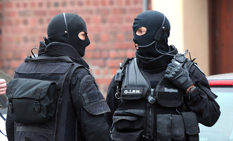 Armed man in hostage standoff in French town
