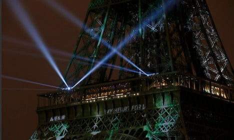 Eiffel Tower goes green for Paris climate summit