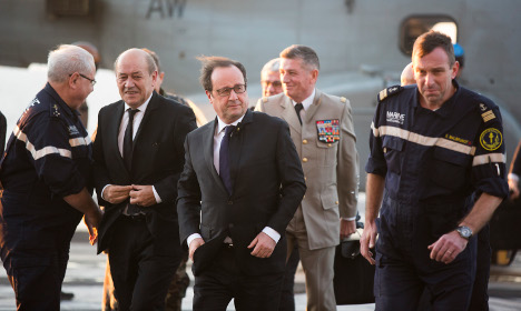 French president visits aircraft carrier off Syria