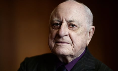 French mogul sells books for AIDs research