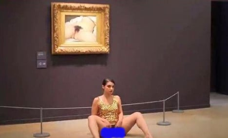 Artist arrested for another nude stunt at Paris gallery