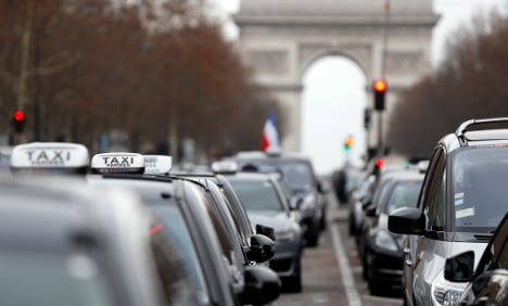 French taxi blockades lifted as Valls vows Uber crackdown