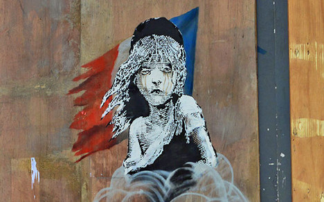 Banksy calls out use of teargas in Calais camp
