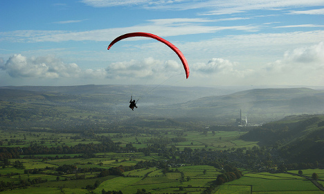Miracle French paraglider, 70, somehow survives fall to earth
