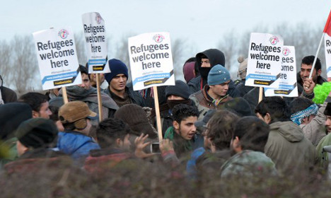 France vows order in Calais after refugees storm ferry