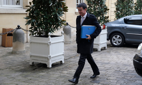 French PM bows to pressure after taxi drivers protest