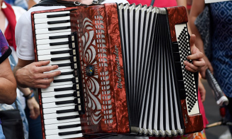 Burglar snared after tripping on Frenchman's accordion
