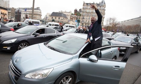 Uber goes offline in France to support minicab strike