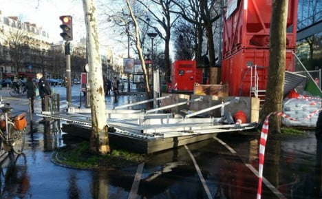 Woman in coma as storm blows over billboard in Paris