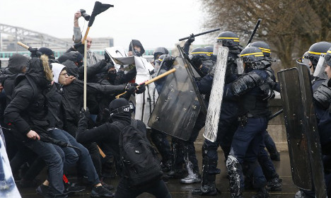 Clashes as French march against labour reforms