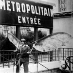 """A strike on the Paris Metro in 1935 forced Parisians to find alternative means to get to work. Actually Birdman here was on his way to an inventors competition and thought it wuld be best to take the Metro. Buy this image by clicking here: <a href=""""http://www.parisenimages.fr/en/collections-gallery/574-6-man-hang-gliders-concours-lepine-french-invention-competition-paris-1935"""">www.parisenimages.fr/en</a>"""