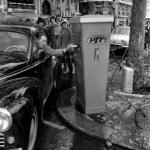 """What!? A mailbox for motorists on the Avenue des Champs-Elysées?!. Can you imagine the chaos today if Parisian drivers stopped their cars to post letters? Oh all that beeping. This was the norm back in April 1959 however. Buy this image by clicking here: <a href=""""http://www.parisenimages.fr/en/collections-gallery/712-3-mailbox-motorists-avenue-champs-elysees-paris-april-1959""""_blank"""">www.parisenimages.fr/en</a>."""