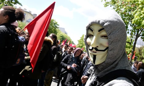 Who are the masked rioters causing havoc in France?