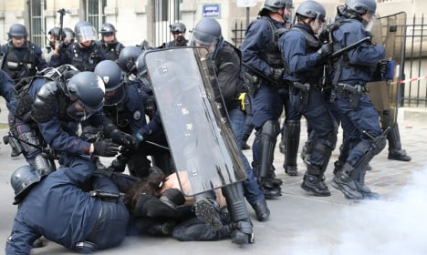 Masked youths clash with police in Paris protest