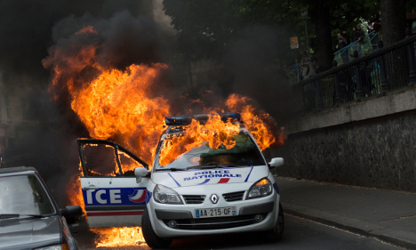 Police car torched in Paris at 'anti-cop hatred' protest