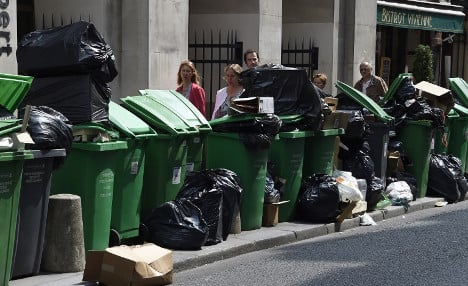 Rubbish piles up on streets of Paris as strikers kick up stink
