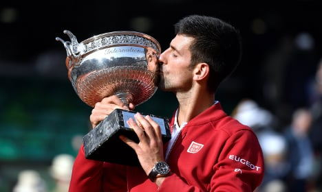 Djokovic joins greats with maiden French Open title
