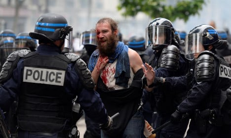 Paris: 'Hundreds' of masked protesters clash with police