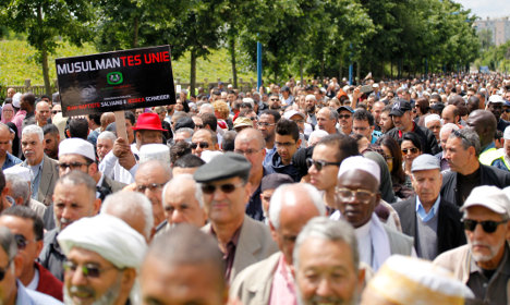 Thousands of Muslims march for slain French police officers