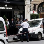 French police hold ten after raids on luxury Paris stores
