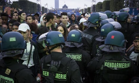 Firecrackers spark panicked stampede at Paris fanzone