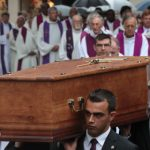 French court charges man over priest murder