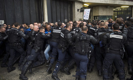 How can France solve the problem of its bursting jails?