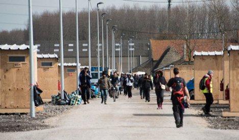 Two injured in shooting at French migrant camp