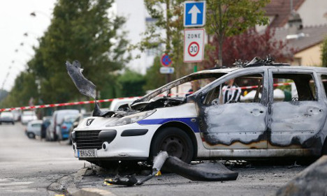 French policeman in coma after fire bomb attack