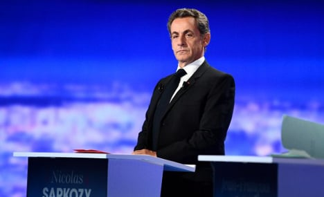 Sarkozy defensive in first French presidential debate
