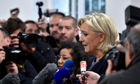 Le Pen opens campaign HQ (up the road from the Elysée)