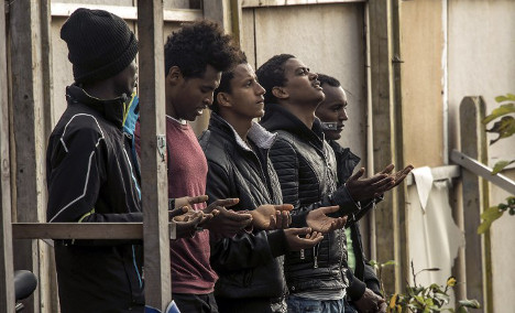 France moves migrant youths from razed 'Jungle' camp
