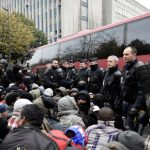 Police in Paris clear 3,800 migrants from street camps